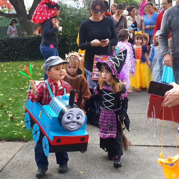 Parents and alumni join us for our annual Halloween parade.